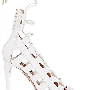 Aquazzura white strappy sandals.